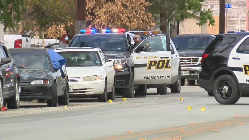 San Antonio police said two males in a black Toyota Nissan opened fire on a house and several vehicles around 4:15 p.m. in the 700 block of Frio City Road.