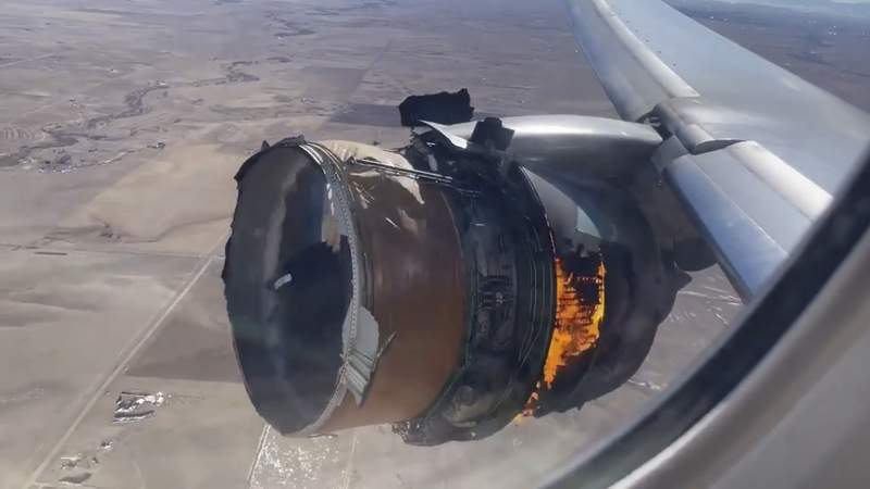 "FILE - In this file photo taken from video, the engine of United Airlines Flight 328 is on fire after experiencing ""a right-engine failure"" shortly after takeoff from Denver International Airport, Saturday, Feb. 20, 2021, in Denver, Colo. Two passengers who were on board the United Airlines airplane that had to make an emergency landing are suing the company in separate suits filed Friday, April 16 in Chicago, where United is based. (Chad Schnell via AP, File)"