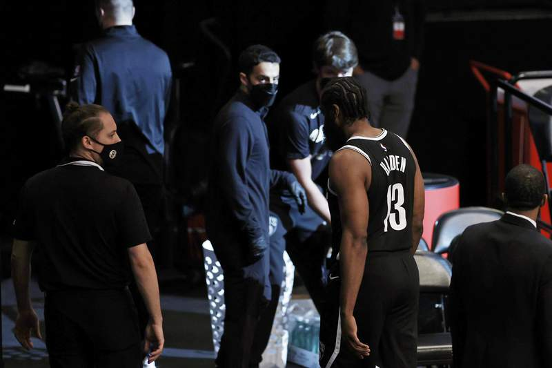 Brooklyn Nets guard James Harden (13) leaves the court early in the first quarter against the Milwaukee Bucks during Game 1 of an NBA basketball second-round playoff series Saturday, June 5, 2021, in New York. (AP Photo/Adam Hunger)