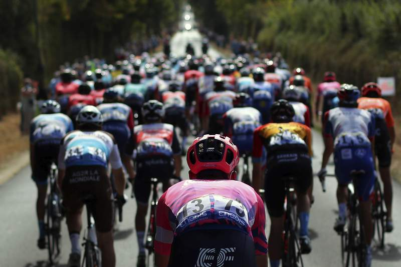Britain's Hugh John Carthy rides in the pack during the stage 12 of the Tour de France cycling race over 218 kilometers from Chauvigny to Sarran, Thursday, Sept. 10, 2020. (AP Photo/Thibault Camus)