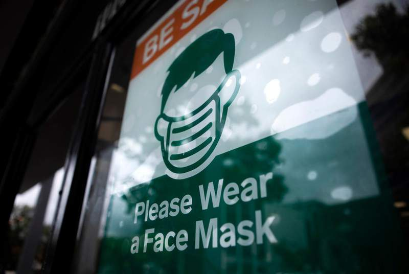 A COVID-19 safety sign last year in Austin. With the statewide mask mandate ending next week, businesses across Texas must now decide whether to require customers to wear face coverings in their establishments. (Credit: Miguel Gutierrez Jr./The Texas Tribune)