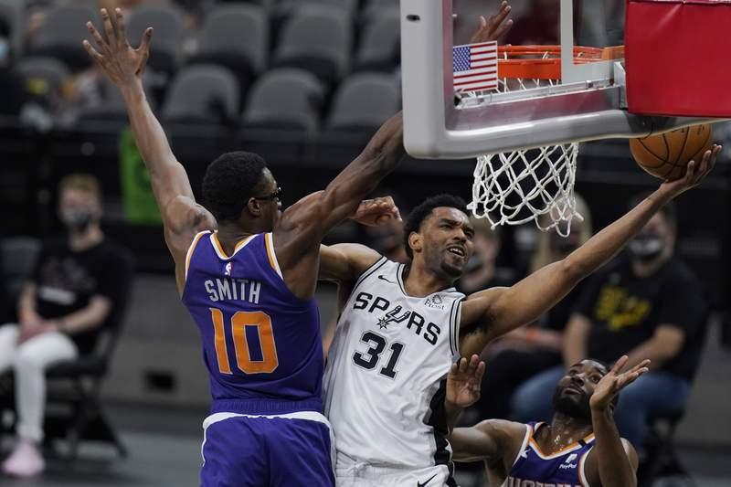 San Antonio Spurs forward Keita Bates-Diop (31) drives to the basket past Phoenix Suns forward Jalen Smith (10) during the second half of an NBA basketball game in San Antonio, Saturday, May 15, 2021. (AP Photo/Eric Gay)