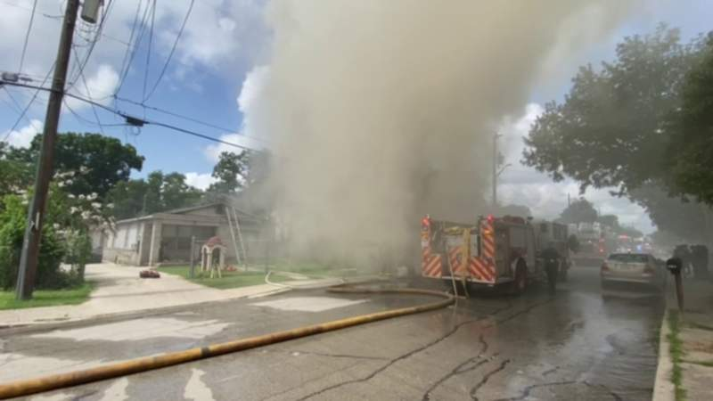 Firefighters battling heavy smoke from house fire on West Side