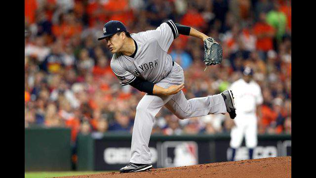 HOUSTON, TEXAS - OCTOBER 12:  Masahiro Tanaka #19 of the New York Yankees delivers the pitch against the Houston Astros during the first inning in game one of the American League Championship Series at Minute Maid Park on October 12, 2019 in Houston, Texas. (Photo by Bob Levey/Getty Images)