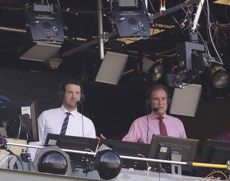 FILE - In this Sept. 24, 2017, file photo, Tony Romo and Jim Nantz work in the broadcast booth before an NFL football game between the Green Bay Packers and the Cincinnati Bengals in Green Bay, Wis.  Nantz and Romo were inseparable when CBS broadcast the Super Bowl two years ago. Next week, they won't see each other until they are in the broadcast booth a couple hours prior to kickoff. Keeping announcers separated until game day has been standard practice this season due to the Coronavirus pandemic. (AP Photo/Morry Gash, File)