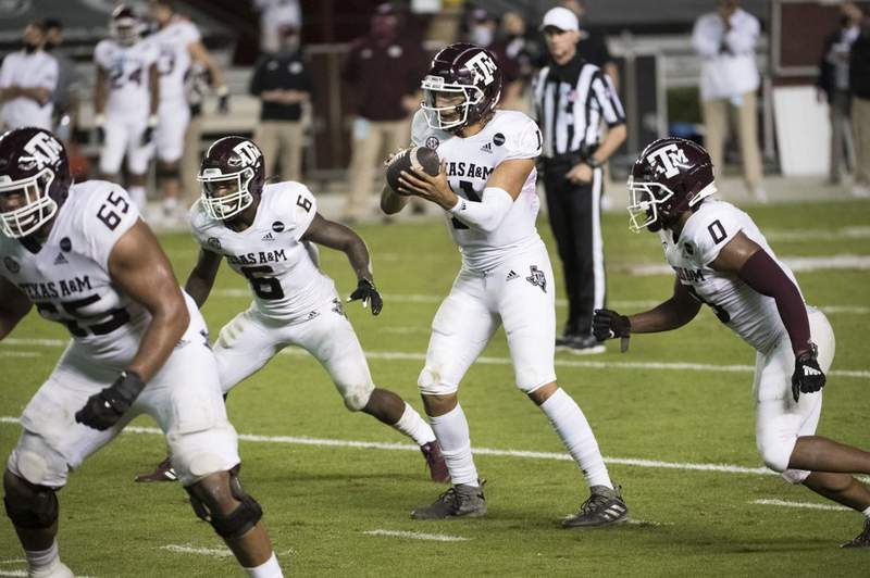 Texas A&M quarterback Kellen Mond (11) takes a snap during the second half of the team's NCAA college football game against South Carolina on Saturday, Nov. 7, 2020, in Columbia, S.C. Texas A&M won 48-3.