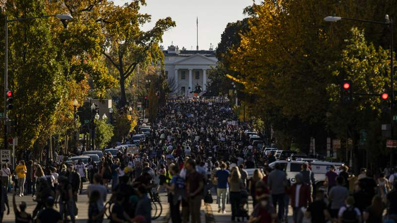 Thousands gather at Black Lives Matter Plaza near the White House to celebrate the announcement that former Vice President, Democratic candidate Joe Biden will be the 46th President of the United States on November 7, 2020 in Washington, DC. Photo by Samuel Corum.