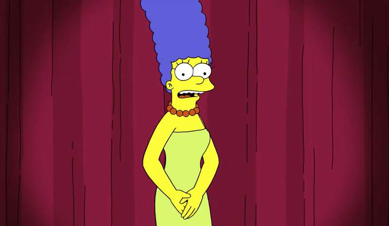 """This image released by Fox shows Marge Simpson, a character on the animated television series """"The Simpsons."""" In the clip, posted by the animated series, matriarch Marge chided a Trump campaign attorney over a tweet comparing her and Democratic presidential contender Joe Biden's pick for his running mate, Sen. Kamala Harris, D-Calif.. (FOX via AP)"""