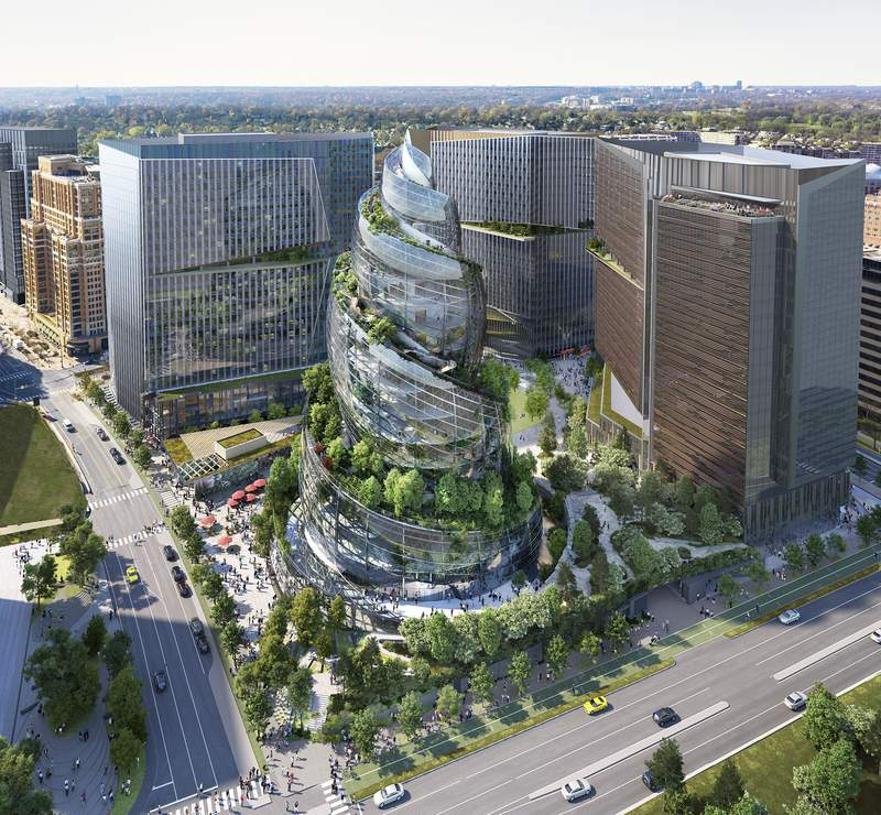FILE - This artist rendering provided by Amazon shows the next phase of the company's headquarters redevelopment to be built in Arlington, Va. The plans released Tuesday, Feb. 2, 2021, features a 350-foot helix-shaped office tower that can be climbed from the outside like a mountain hike. Amazon is making its first foray into providing health care services, announcing Wednesday, March 17, 2021, that it will be offering its Amazon Care telemedicine program to employers nationwide. (NBBJ/Amazon via AP, File)