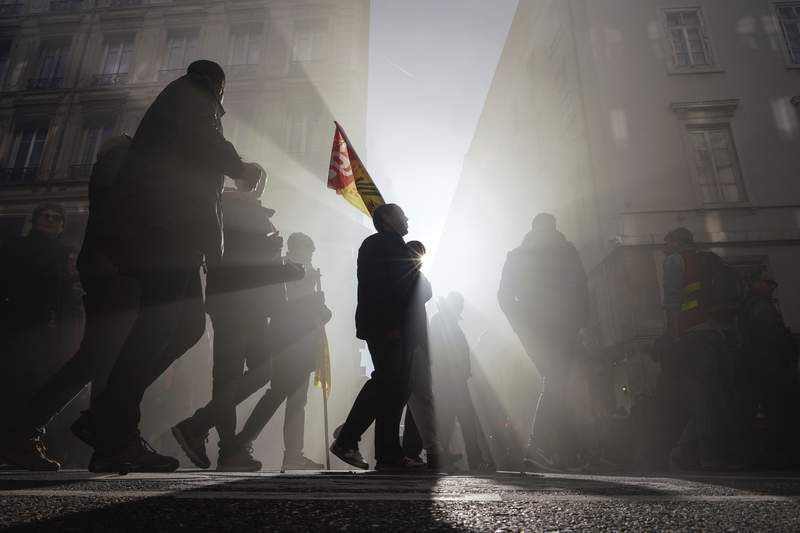 Protesters march during a demonstration in Lyon, central France, Thursday, Jan. 16, 2020. Protesters denounced French President Emmanuel Macron's plans to overhaul the pension system. (AP Photo/Laurent Cipriani)
