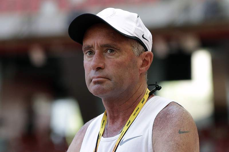 FILE - In this Aug. 21, 2015, file photo, Alberto Salazar watches a training session for the World Athletic Championships at the Bird's Nest stadium in Beijing. Salazar has been permanently banned by the U.S. Center for SafeSport for sexual and emotional misconduct. Salazar has 10 days to appeal the decision. (AP Photo/Kin Cheung, File)