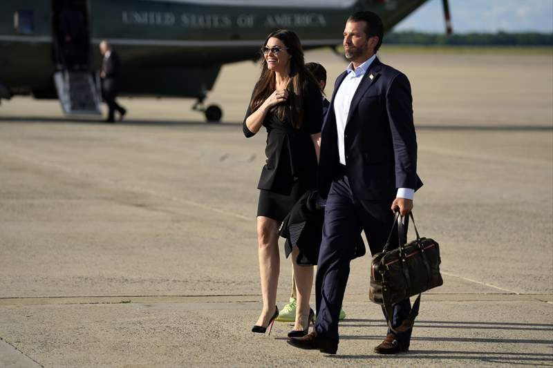 Donald Trump Jr., walks with Kimberly Guilfoyle after arriving at Andrews Air Force Base, Md., Wednesday, May 27, 2020, after traveling to Florida, with President Donald Trump. (AP Photo/Evan Vucci)
