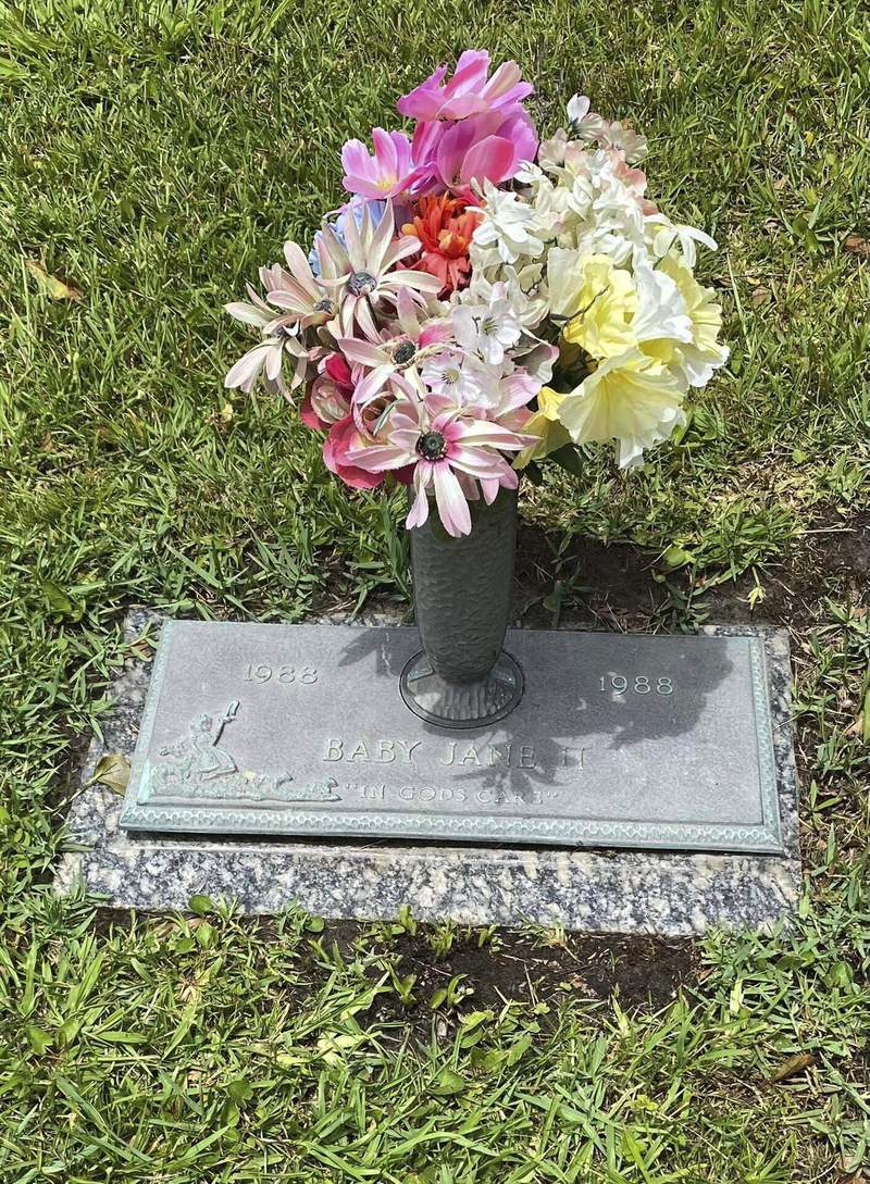 This photo provided by the Jackson County Sheriffs Department shows the grave marker of Baby Jane II at Jackson County Memorial Park in Pascagoula, Mississippi. The weeks-old infant, found in the Pascagoula River in 1988, was never identified. She was buried by community members next to the grave site of another unidentified infant found in a Jackson County river in the 1980s called Baby Jane. (Matt Hoggatt/Jackson County Sheriffs Department via AP)