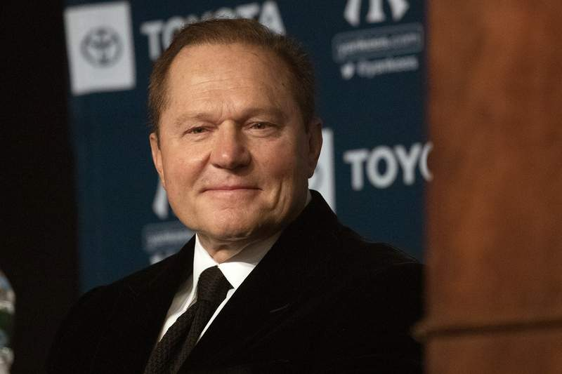 FILE - In this Dec. 18, 2019, file photo, sports agent Scott Boras listens as Gerrit Cole is introduced as the newest New York Yankees player during a baseball media availability in New York. Boras recommends his clients refuse Major League Baseballs attempt to cut salaries during negotiations with the players association, claiming team financial issues caused by the coronavirus pandemic have their origin in management debt financing. (AP Photo/Mark Lennihan, File)
