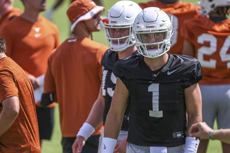 Texas quarterback Hudson Card (11) attends an NCAA college football practice Saturday, Aug. 7, 2021, in Austin, Texas.