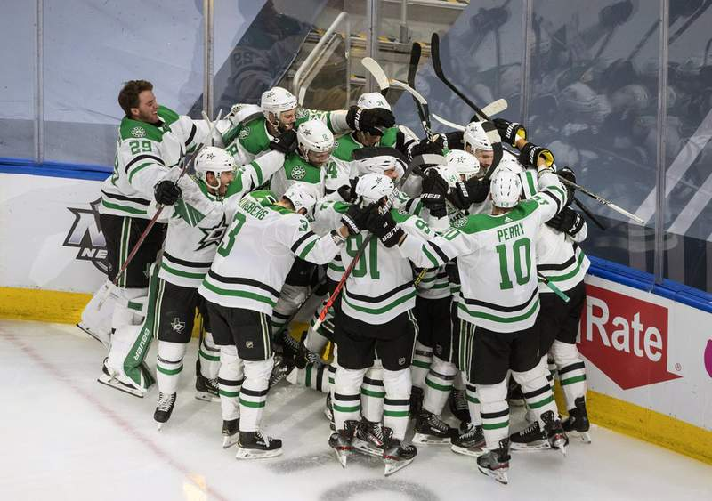 Dallas Stars celebrate their win over the Colorado Avalanche during overtime NHL Western Conference Stanley Cup playoff game action in Edmonton, Alberta, Friday, Sept. 4, 2020.
