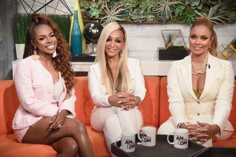 """Candiace Dillard, Karen Huger and Gizelle Bryant of the reality series """"Real Housewives of Potomac"""" visit BuzzFeed's """"AM To DM"""" on August 26, 2019 in New York City. (Photo by Gary Gershoff/Getty Images)"""