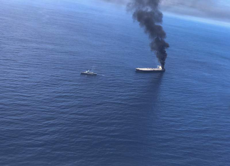 This Thursday, Sept.3, 2020 photo released by Sri Lankan Air Force shows smoke rising after a fire broke out on a Panama-registered oil tanker about 38 nautical miles (70 kilometers) east of Sri Lanka. Sri Lanka's government is sending scientists to determine whether a three-day fire on a giant oil tanker off its coast damaged the marine environment, an official said Monday. (Sri Lankan Air Force via AP)
