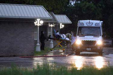 Healthcare workers transport a patient on a stretcher from the Southeast Nursing and Rehabilitation Center nursing home in San Antonio on April 4, 2020. (Go Nakamura/REUTERS)