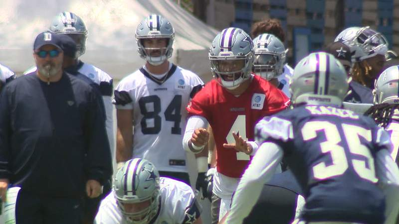 Quarterback Dak Prescott takes a snap on the first day of Cowboys training camp in Oxnard, California on Wednesday, July 21, 2021.