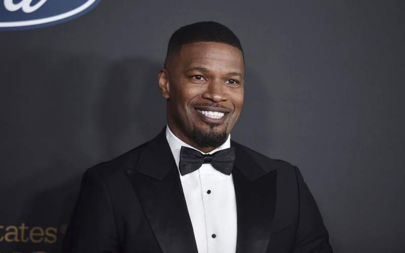 FILE - In this Feb. 22, 2020, file photo, Jamie Foxx arrives at the 51st NAACP Image Awards at the Pasadena Civic Auditorium in Pasadena, Calif. The Pixar film Soul will skip theaters and instead premiere on Disney+ on Christmas, the Walt Disney Co. announced Thursday, Oct. 8, 2020, sending one of the fall's last big movies straight to streaming. The film, about a middle school teacher played by Foxx, with dreams of becoming a jazz musician, was originally to premiere at the Cannes Film Festival. (Photo by Richard Shotwell/Invision/AP, File)