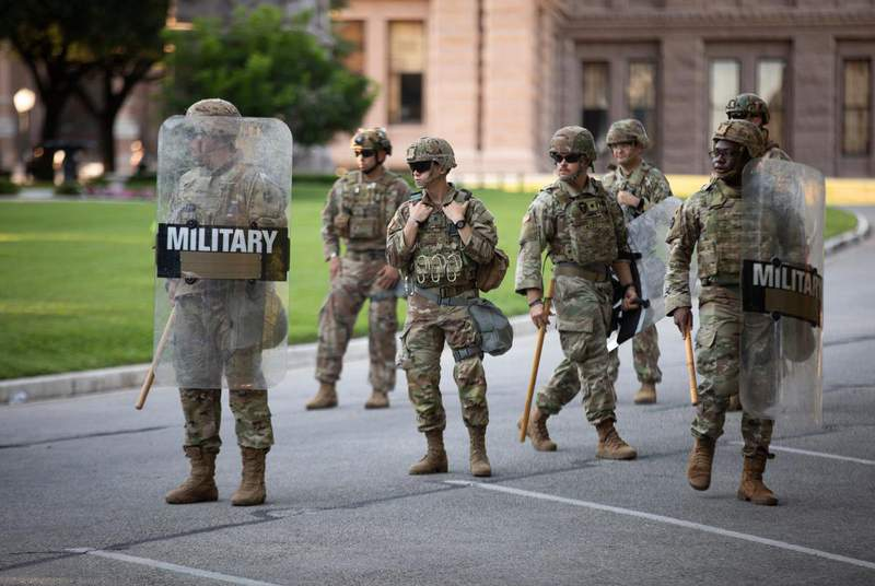 Texas National Guard troops at the Texas state Capitol during a protest over the death of George Floyd on June 19, 2020.                    Credit: Miguel Gutierrez Jr./The Texas Tribune