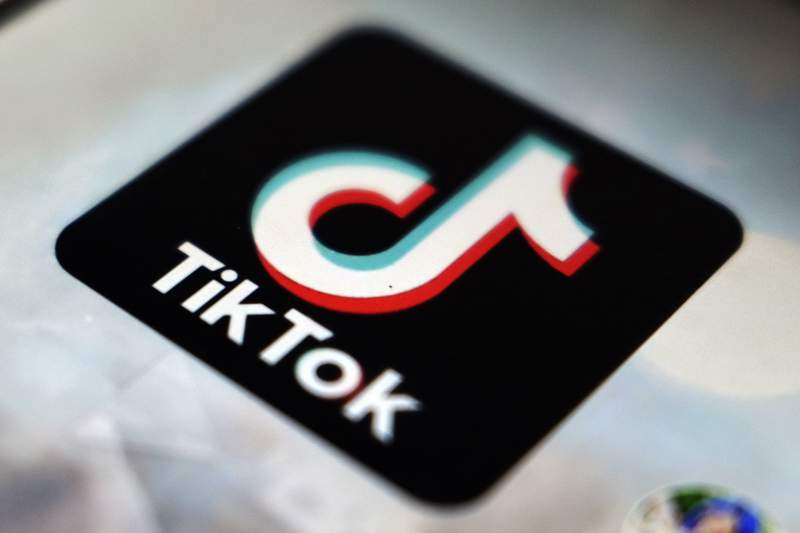 FILE - In this Sept. 28, 2020 file photo, a view of the TikTok app logo, in Tokyo.  The Biden administration is putting on hold a deal brokered by the Trump administration that would have had Oracle and Walmart buying a big stake in popular video app TikTok, according to a report in the Wall Street Journal, Wednesday, Feb. 10, 2021.  (AP Photo/Kiichiro Sato, File)