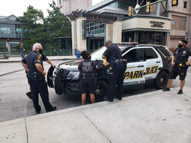 A man was arrested Friday, Aug. 28 after San Antonio police say he ran away from a park police officer and tried to reach into his pants, possibly trying to reach a weapon. Police found a gun and a wad of cash on him.