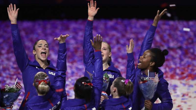 The US Women's Gymnastics Olympics Team reacts after being named to represent the USA at the 2016 Olympics during day 2 of the 2016 U.S. Olympic Women's Gymnastics Team Trials. Photo by Ronald Martinez