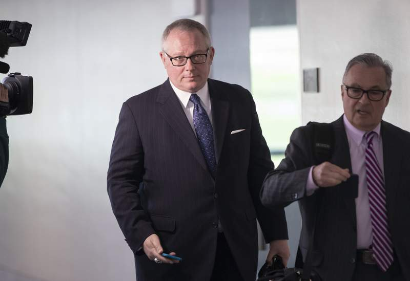 FILE - In this May 1, 2018, file photo, Former Donald Trump campaign official Michael Caputo, left, joined by his attorney Dennis C. Vacco, leaves after being interviewed by Senate Intelligence Committee staff investigating Russian meddling in the 2016 presidential election, on Capitol Hill in Washington. A House subcommittee examining President Donald Trumps response to the coronavirus pandemic is launching an investigation into reports that political appointees have meddled with routine government scientific data to better align with Trumps public statements. The Democrat-led subcommittee said Sept. 14, 2020 that it is requesting transcribed interviews with seven officials from the Centers for Disease Control and Prevention and the Department of Health and Human Services, including communications aide Michael Caputo. (AP Photo/J. Scott Applewhite, File)