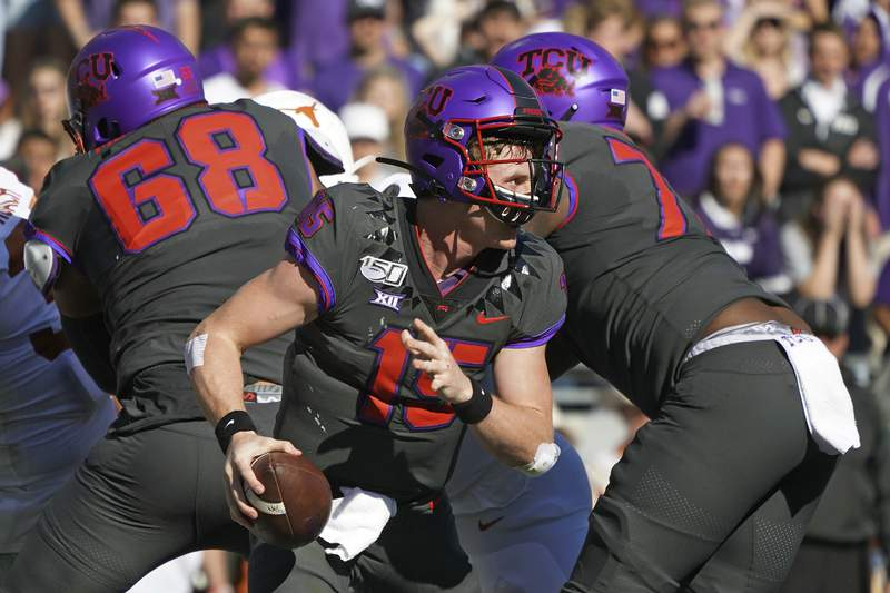TCU quarterback Max Duggan (15) scrambles out of the pocket in the first half of an NCAA college football game against Texas in Fort Worth, Texas, Saturday, Oct. 26, 2019. (AP Photo/Louis DeLuca)