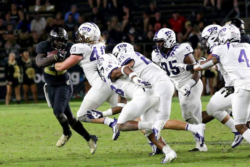 Purdue running back King Doerue runs the ball against the Texas Christian University defense during a NCAA football game on Sept. 14, 2019 at Ross-Ade Stadium in West Lafayette.