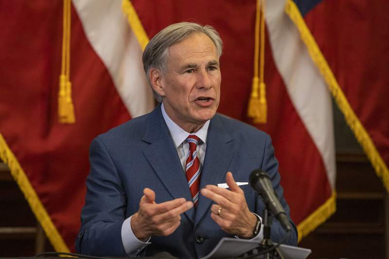 Texas Gov. Greg Abbott announces the reopening of more Texas businesses during the COVID-19 pandemic at a press conference at the Texas State Capitol in Austin on Monday, May 18, 2020. Abbott said that childcare facilities, youth camps, some professional sports, and bars may now begin to fully or partially reopen their facilities as outlined by regulations listed on the Open Texas website. (Lynda M. Gonzalez/The Dallas Morning News via AP, Pool)