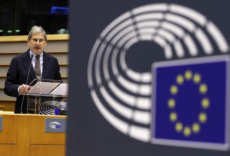European Commissioner for Budget Johannes Hahn addresses the European Parliament during a plenary session, in Brussels, Wednesday, Nov. 11, 2020. (Yves Herman, Pool via AP)