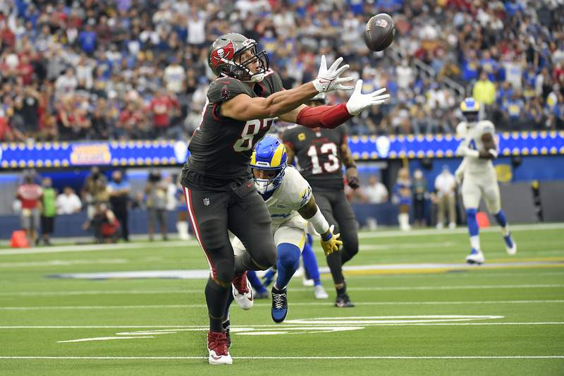 Tampa Bay Buccaneers tight end Rob Gronkowski reaches but cannot make a catch during the first half of an NFL football game against the Los Angeles Rams Sunday, Sept. 26, 2021, in Inglewood, Calif. (AP Photo/Kevork Djansezian)