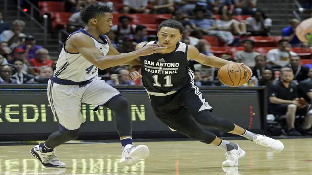 San Antonio Spurs guard Bryn Forbes (11) drives as Utah Jazz guard Donovan Mitchell (45) defends during the first half of an NBA summer league basketball game Monday, July 3, 2017, in Salt Lake City. (AP Photo/Rick Bowmer)