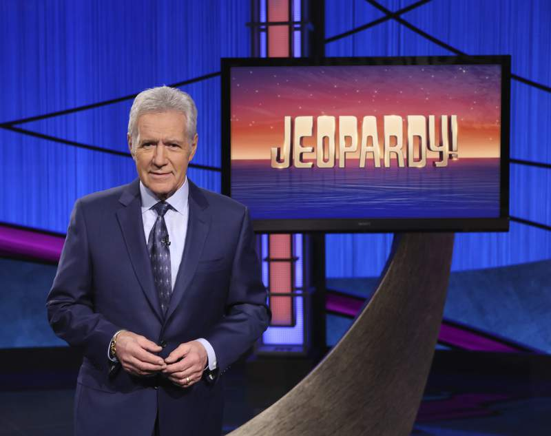 """This image released by Jeopardy! shows Alex Trebek, host of the game show """"Jeopardy!"""" Trebek's memoir, """"The Answer Is: Reflections on My Life,"""" will be released on Tuesday, July 21. (Jeopardy! via AP)"""