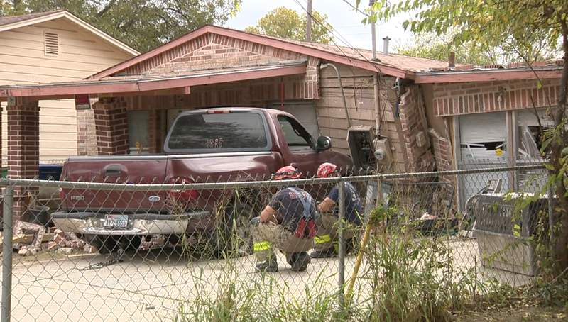 A search is underway for a driver accused of ramming his truck into his neighbor's Southwest Side home multiple times after an argument, according to San Antonio police.