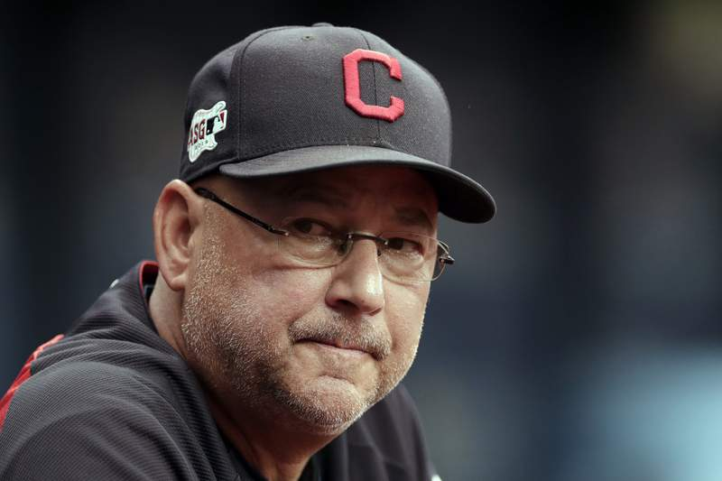 FILE - In this Sept. 1, 2019, file photo, Cleveland Indians manager Terry Francona watches during the first inning of a baseball game against the Tampa Bay Rays in St. Petersburg, Fla. The Cleveland Indians expect manager Terry Francona to return for the 2021 season after he missed 47 games this season due to health reasons. Team president Chris Antonetti said Tuesday, Oct. 6, 2020, that the 61-year Francona is back home in Arizona resting and recovering. Francona was hospitalized this season after undergoing surgery for a gastrointestinal issue and then dealing with blood clotting complications.(AP Photo/Chris O'Meara, File)