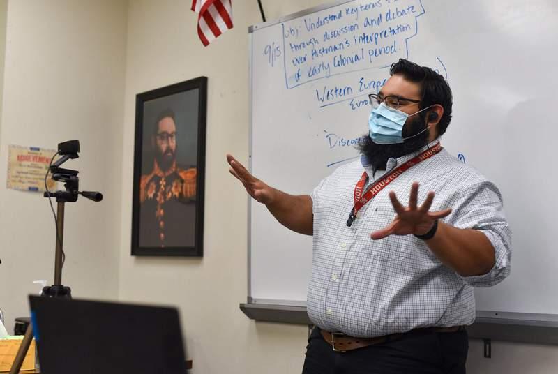 U.S. history teacher Cris Hernandez instructs a class remotely in an empty classroom at Westfield High School.                    Credit: Amna Ijaz/The Texas Tribune
