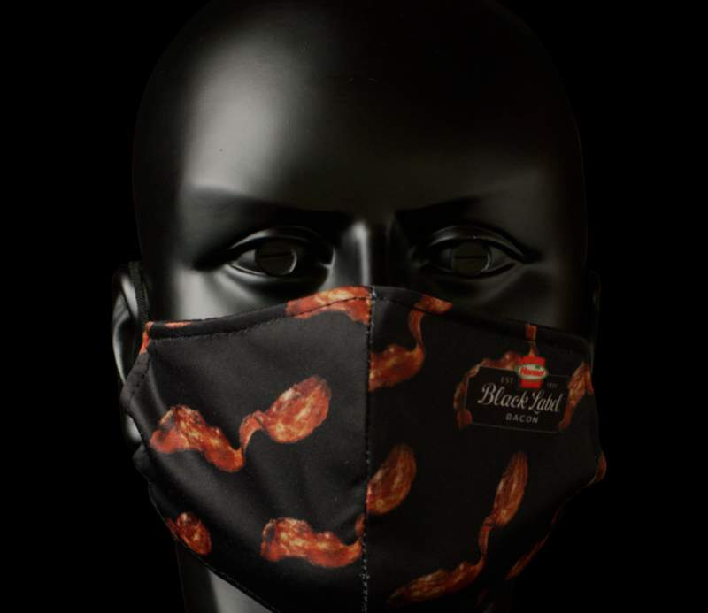 """The Hormel Foods Corporation, known for its Black Label Bacon, announced the launch of its """"Breathable Bacon"""" face mask on social media earlier this week as part of an exclusive giveaway. (Credit: Hormel Foods website)"""