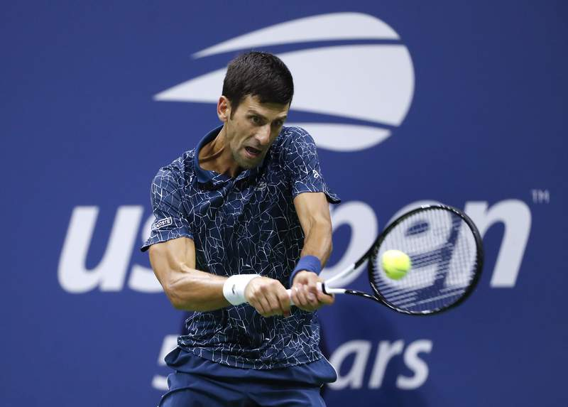 FILE - In this Sept. 9, 2018, file photo, Novak Djokovic, of Serbia, returns a shot to Juan Martin del Potro, of Argentina, during the men's final of the U.S. Open tennis tournament in New York. Djokovic is fretting about harsh restrictions on players entourages and other extreme changes proposed for the U.S. Open, if it is played starting in August. (AP Photo/Adam Hunger, File)