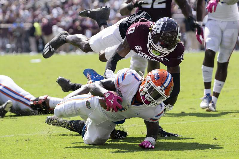 Florida wide receiver Kadarius Toney (1) is stopped just short of the goal line by Texas A&M defensive back Myles Jones (0) during the second quarter of an NCAA college football game, Saturday, Oct. 10, 2020, in College Station, Texas. (AP Photo/Sam Craft)