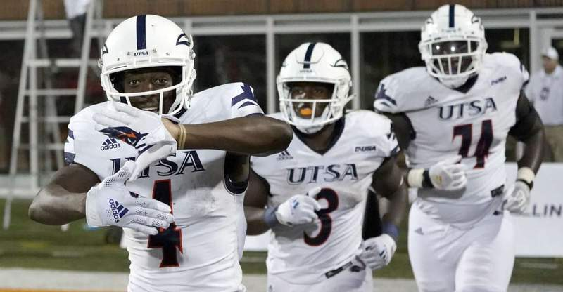 UTSA's Zakhari Franklin, left, celebrates his touchdown reception during the second half of an NCAA college football game against Illinois, Saturday, Sept. 4, 2021, in Champaign, Ill.