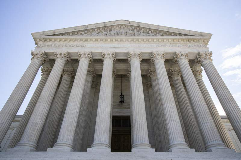 FILE - In this June 30, 2020, file photo the U.S. Supreme Court is seen in Washington. President Donald Trump didn't have to look very far for one of the contenders on his short list to replace the late Ruth Bader Ginsburg on the Supreme Court: he's been considering one of his own lawyers. Kate Comerford Todd is a deputy White House counsel, helping navigate Trump's White House through a thicket of legal issues. (AP Photo/Manuel Balce Ceneta, File)