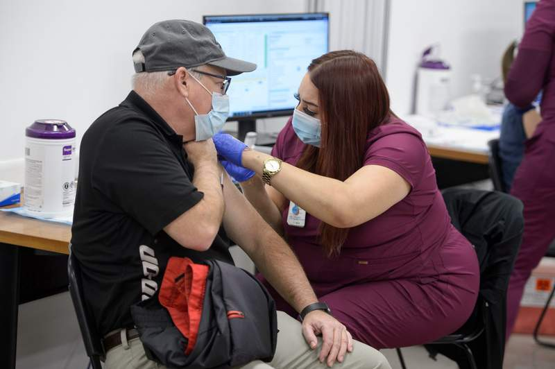 A University Health team member administers the COVID-19 vaccine at Wonderland Mall. Courtesy: Mark Greenberg, Photographer / Visual Content Creator, University Health
