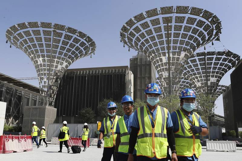 FILE - In this Oct. 8, 2019, file photo, technicians walk at the three thematic districts at the under construction site of the Expo 2020 in Dubai, United Arab Emirates. The United States, on Wednesday, Jan. 15, 2020, said its participation at this year's World's Fair in Dubai is being made possible by the generosity of the Emirati government. (AP Photo/Kamran Jebreili)