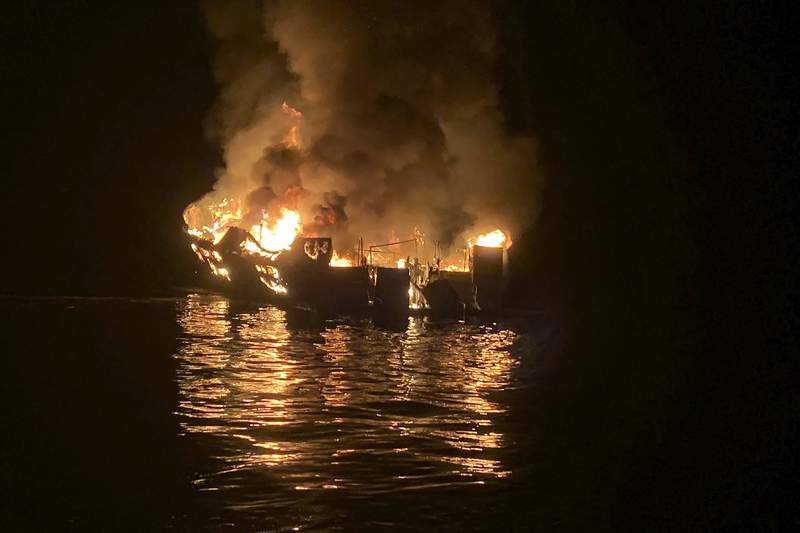 FILE - In this Sept. 2, 2019, file photo provided by the Santa Barbara County Fire Department, the dive boat Conception is engulfed in flames after a deadly fire broke out aboard the commercial scuba diving vessel off the Southern California Coast. Court documents say criminal charges are imminent in the investigation of the fire that killed 34 people aboard the scuba boat Conception last year off the coast of Southern California. (Santa Barbara County Fire Department via AP, File)