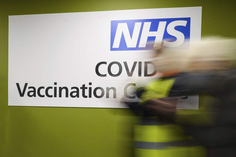 FILE - In this Thursday, Jan. 14, 2021 file photo, a sign in the interior of the NHS vaccination centre in Robertson House, Stevenage, England. An Italian man living in Berlin has on Friday Feb. 26, 2021 been convicted of attempted extortion for threatening to blow up a British National Health Service hospital unless he was paid off with 10 million pounds ($13.2 million) in crypto currency. Defendant Emil A., whose last name wasnt given in line with German privacy laws, was sentenced to three years in prison.(Leon Neal/Pool Photo via AP, file)