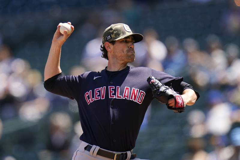 Cleveland Indians starting pitcher Shane Bieber throws against the Seattle Mariners in the first inning of a baseball game Sunday, May 16, 2021, in Seattle. (AP Photo/Elaine Thompson)